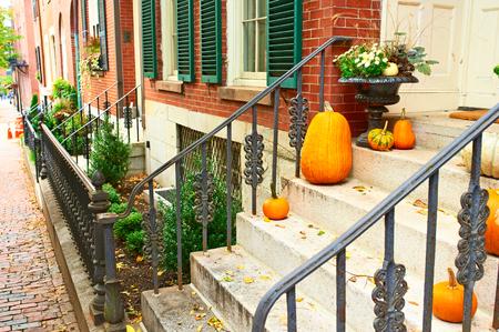 old street: Pumpkins near the door during Halloween season Stock Photo
