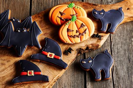 gingerbread cookies: Halloween homemade gingerbread cookies over wooden table Stock Photo