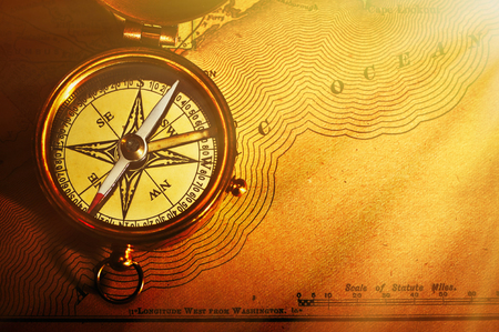 44812165 antique brass compass over old usa map background