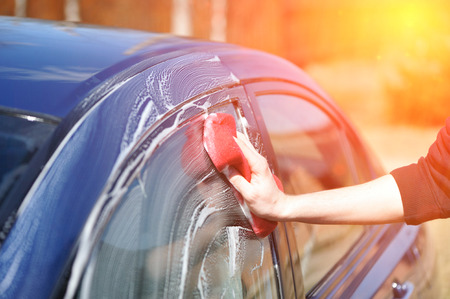 Blue car washing on open air Stock Photo