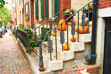 houses row: Pumpkins near the door during Halloween season Stock Photo