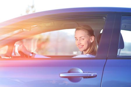 new car: Happy woman in new blue car