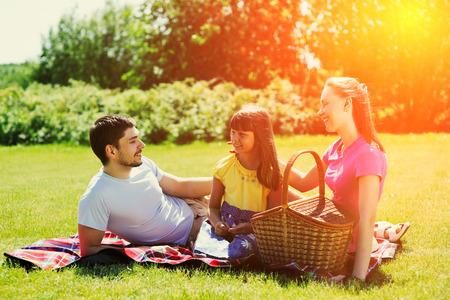 picnic food: Family on picnic at sunny day Stock Photo