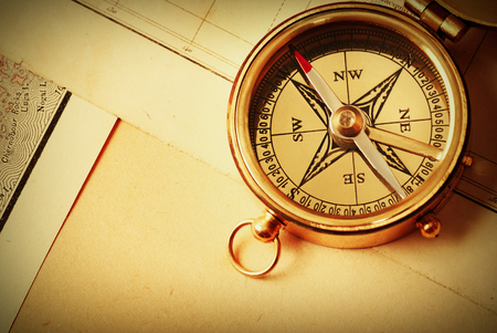 traverse: Antique brass compass over old map