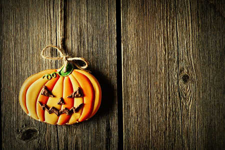 halloween background: Halloween homemade gingerbread cookie over wooden background Stock Photo