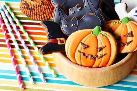 dessert table: Halloween homemade gingerbread cookies over tablecloth