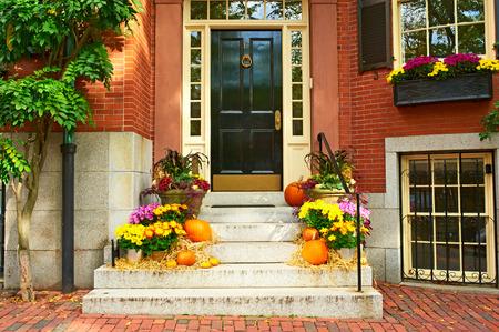 outside house: Pumpkins near the door during Halloween season Stock Photo