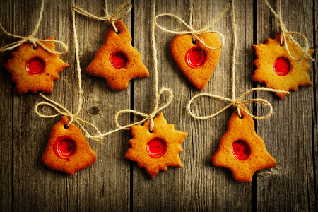 gingerbread cookies: Christmas homemade gingerbread cookies over wooden table