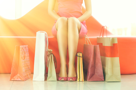 shopper: Woman with bags in shopping mall