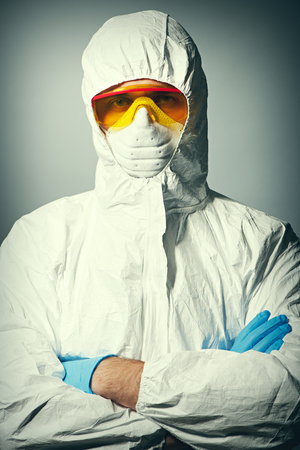 protective wear: Scientist in protective wear, glasses and respirator