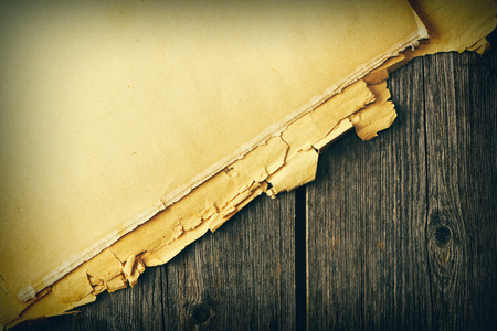 torn paper: Old torn paper on wood planks background Stock Photo