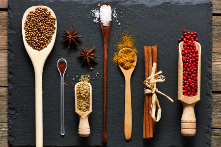 curry spices: Spices in wooden utensils over slate