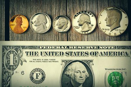 uncirculated: New uncirculated US money over wooden background Stock Photo