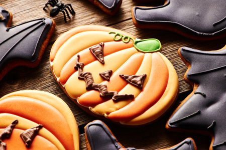 wood spider: Halloween homemade gingerbread cookies over wooden table Stock Photo