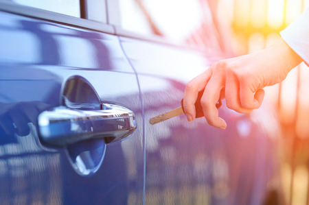 car door: Car key in womans hand Stock Photo