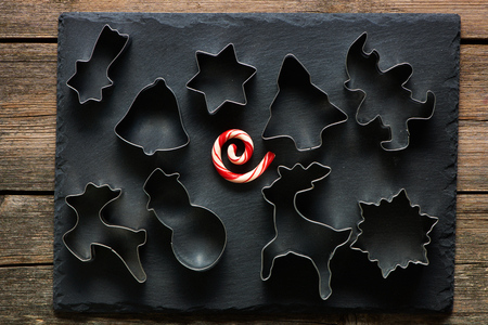 stone cutter: Christmas cookie cutters on slate