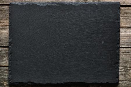 Slate über alte Holz-Hintergrund Lizenzfreie Bilder