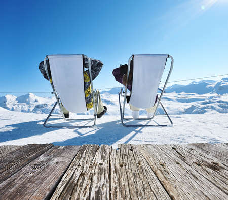 deck: Couple at mountains in winter, Val-dIsere, Alps, France