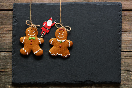 gingerbread cookies: Christmas homemade gingerbread couple cookies over slate Stock Photo