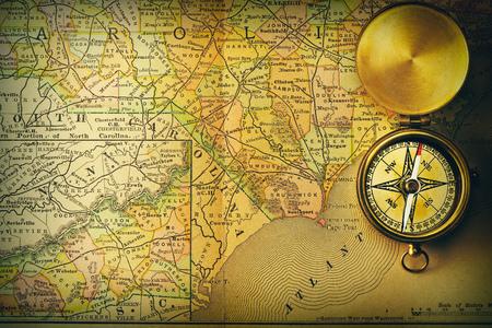 compass: Antique brass compass over old XIX century map