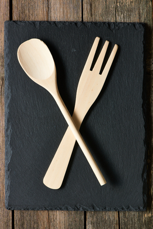 dark grey slate: Wooden kitchen utensils on slate