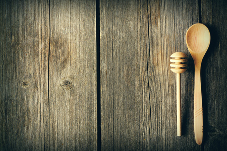 dipper: Wooden spoon and dipper on table