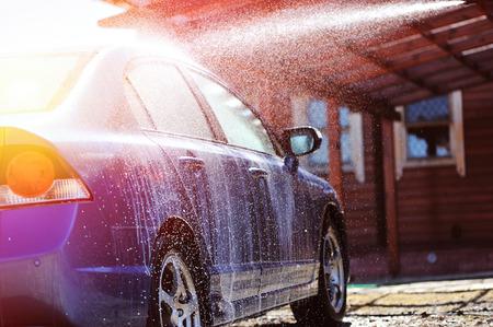 Blue car washing on open air Standard-Bild
