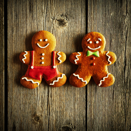 holiday food: Christmas homemade gingerbread man on wooden table