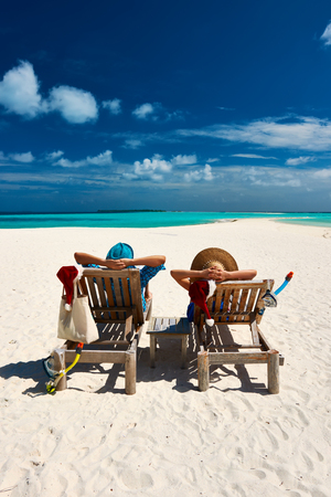 casual: Couple relax on a tropical beach at christmas Stock Photo