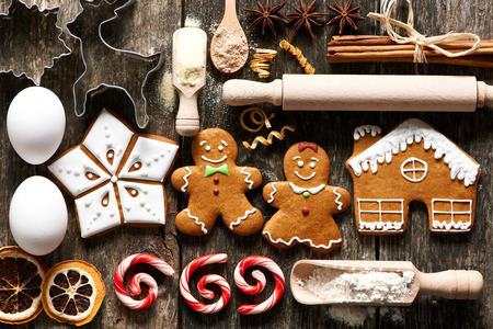 holiday tradition: Kitchen utensils and ingredients for christmas homemade gingerbread cookies on wooden table