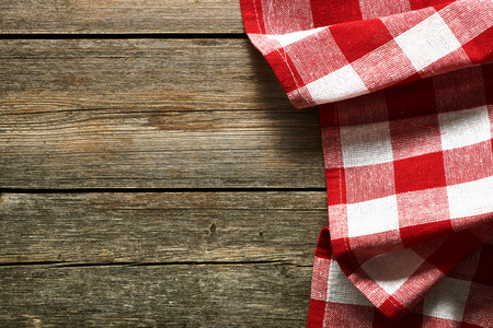 Red tablecloth on rustic background