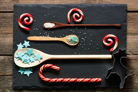 stone cutter: Sugar sprinkle dots on and candies slate background