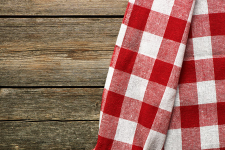 red tablecloth: Red tablecloth on rustic background