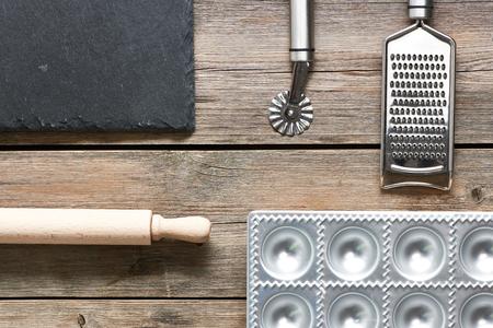kitchen utensils: Kitchen utensils for homemade pasta ravioli on wooden table