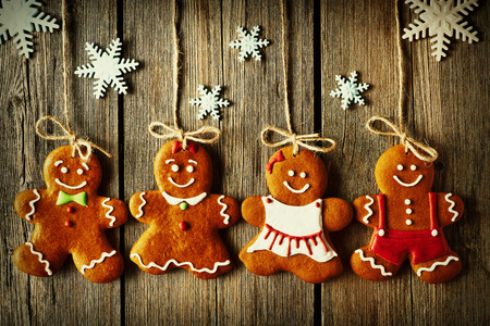 christmas woman: Christmas homemade gingerbread couple cookies over wooden background Stock Photo