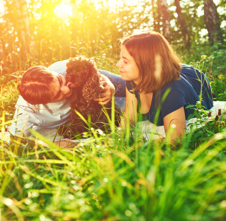 Beautiful couple with dog outdoors photo