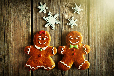 winter wood: Christmas homemade gingerbread couple cookies on wooden table