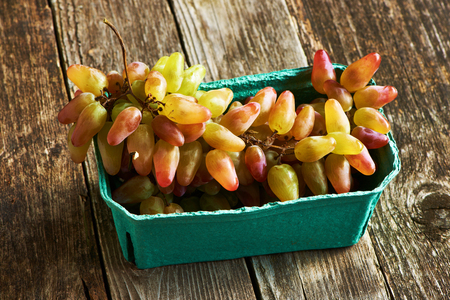 ripe: Fresh grapes on old wooden background Stock Photo