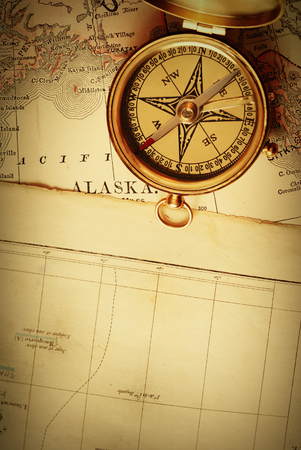 alaska map: Antique brass compass over old Alaska map Stock Photo