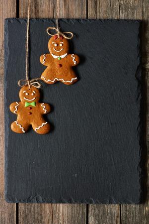 Christmas homemade gingerbread couple cookies over slate Standard-Bild