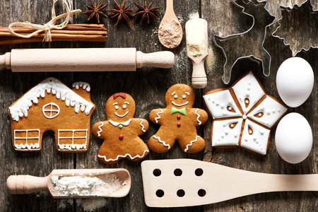gingerbread cookie: Kitchen utensils and ingredients for christmas homemade gingerbread cookies on wooden table