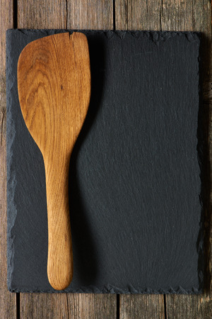 wood texture: Wooden spatula on slate background