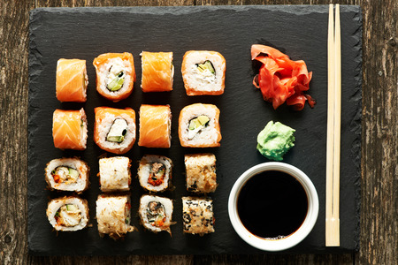 sushi chopsticks: Sushi rolls on a slate plate