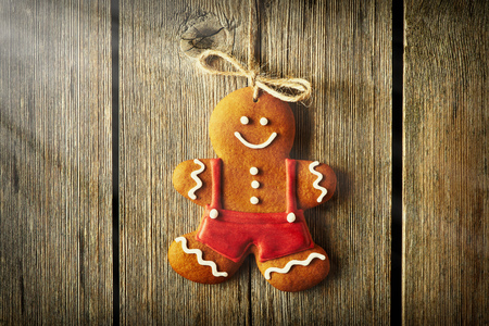 gingerbread man: Christmas homemade gingerbread man over wooden background Stock Photo