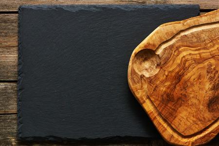 plank: Olive wood cutting board over slate