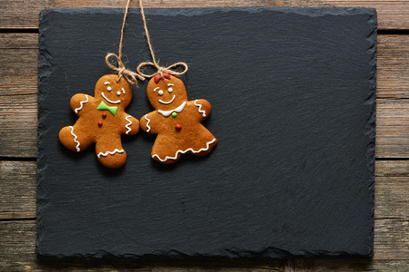 gingerbread cookies: Christmas homemade gingerbread couple cookies over slate Stock Photo