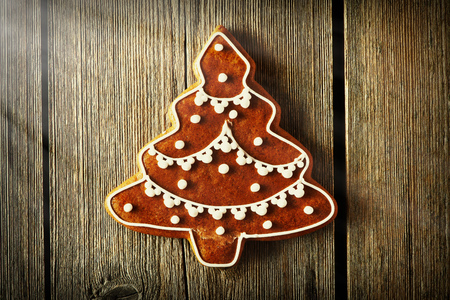 holiday tradition: Christmas homemade gingerbread cookie on wooden table Stock Photo