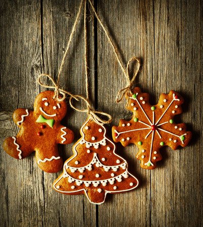 gingerbread cookies: Christmas homemade gingerbread cookies over wooden background Stock Photo