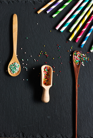 sprinkle: Drinking straws and sugar sprinkle dots on slate background