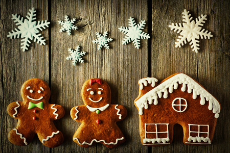 christmas house: Christmas homemade gingerbread couple and house on wooden table